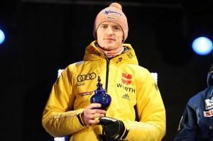 SFC_Vikersund_2012_Severin_Freund_on_medal_ceremony